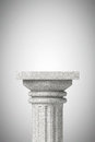 Stone classic greek column on a concrete background Stock Photos