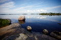 Stone coast of the lake water landscape with stones stones in water with stones beautiful landscape water smooth surface and blue Stock Image