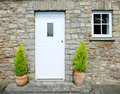 Stone cottage door Stock Photography