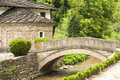 Stone countryhouse and stone bridge Royalty Free Stock Photo
