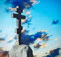 Stone cross on the background of the dawn sky Royalty Free Stock Images