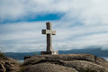 Stone cross in cape finisterre traditional erected along the coast of galicia spain Stock Photos