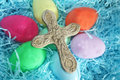 Stone cross sits top colored easter eggs Stock Photography