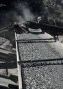 Stone crushing plant which crushes the to shingle gravel and fine sand and becomes transported by conveyor belt to the Stock Photography