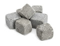 Stone cubes pile of on white Stock Photos