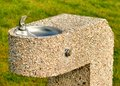 Stone drinking fountain in a public park Stock Photography