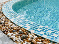 Stone on the edge of the swimming pool Royalty Free Stock Photo