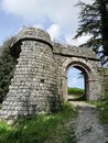 Stone entrance along the wall surrounding a medieval village Royalty Free Stock Photo
