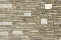 Stone facade the beige bricks as background Royalty Free Stock Images