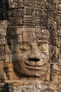 Stone face in the bayon angkor cambodia is a well known and richly decorated khmer temple at built late th Stock Images