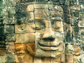 Stone face in Bayon temple Stock Photos