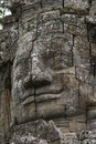 Stone face at Bayon temple, Angkor Wat, Cambodia Royalty Free Stock Photo