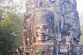 Stone face statue in ancient Bayon Temple Angkor Thom, Cambodia. Royalty Free Stock Photo