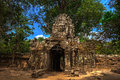 Stone face at ta som temple entry architecture of old buddhist in angkor archeological area Stock Photos