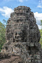 Stone faces at Bayon temple, Angkor Wat, Cambodia Royalty Free Stock Photo
