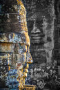 Stone faces at the bayon temple in siem reap cambodia multiple Royalty Free Stock Photos