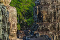 Stone faces at the bayon temple in siem reap cambodia multiple Stock Photo