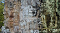 Stone faces at the bayon temple in siem reap cambodia multiple Royalty Free Stock Photo
