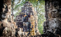 Stone faces at the bayon temple in siem reap cambodia multiple Royalty Free Stock Photography