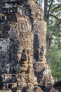 Stone faces at the bayon temple in siem reap cambodia multiple Stock Photos