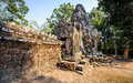Stone faces at the entrance to a temple in siem reap cambodia walled one of temples Stock Images