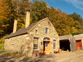Stone farm house old and barns in autumn Royalty Free Stock Photo
