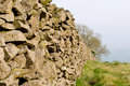Stone field boundary wall Royalty Free Stock Photo