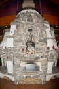 Stone fire place inside wooden cabin Royalty Free Stock Photos