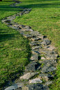 Stone footpath in the garden Royalty Free Stock Image