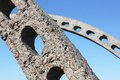 Stone framework of a structure arch against the sky Stock Photos