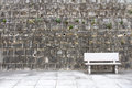 Stone garden seat and concrete wall Stock Photos