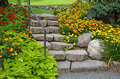 Stone garden staircase with beautiful summer flowers Royalty Free Stock Photo