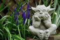 Stone gargoyle in the garden Royalty Free Stock Photo