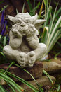 Stone gargoyle meditating - vertical Royalty Free Stock Photo