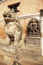 Stone Guardian and Hindu Deity, Bhaktapur, Nepal Royalty Free Stock Photos