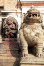 Stone Guardian and Hindu Deity, Bhaktapur, Nepal Royalty Free Stock Photography