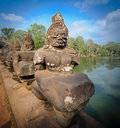 Stone guardians on a bridge at the entrance to a temple in siem reap cambodia lining by one of entrances Stock Image