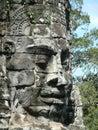 Stone head in Angkor Wat, Cambodia Royalty Free Stock Photo