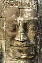 Stone head on towers of Bayon temple Stock Photo
