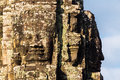 Stone head on towers of bayon temple in angkor thom cambodia Royalty Free Stock Image