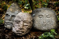 Stone heads sculpted in the grass Royalty Free Stock Images