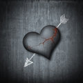 Stone heart hit from the arrow of the love is revived Royalty Free Stock Photo