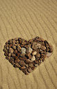 Stone heart made of stones in the sand Royalty Free Stock Photo