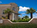 Stone house and palm tree Stock Photos