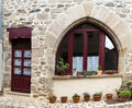 Stone house purpel wood door window Stock Photography