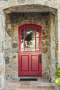 Stone house and red front door Royalty Free Stock Photo