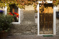 Stone house wood door bardolino italy in a town on the south east shores of lake garda lago di garda in lombardy Stock Photography