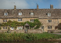 Stone houses in lower slaughter cotswolds england view of and stream Royalty Free Stock Image