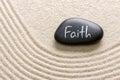A stone with the inscription faith black Stock Photos