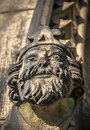 Stone king carved sandstone s head on the outside of bakewell church Royalty Free Stock Image